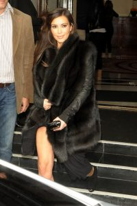 Reality TV babe Kim Kardashian is seen leaving her hotel dressed in black in London