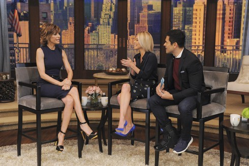 Kelly Ripa and Mark Consuelos are pictured with Lisa Rinna during the production of