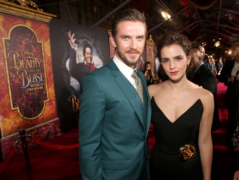 LOS ANGELES, CA - MARCH 02: Actors Dan Stevens and Emma Watson arrive for the world premiere of Disney's live-action