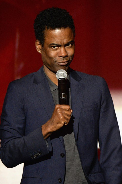 MIAMI BEACH, FL - DECEMBER 02:  Comedian Chris Rock speaks onstage during An Evening of Music, Art, Mischief and Performance to benefit Raising Malawi presented by Madonna at Faena Forum on December 2, 2016 in Miami Beach, Florida.  (Photo by Kevin Mazur/Getty Images for Bulgari)